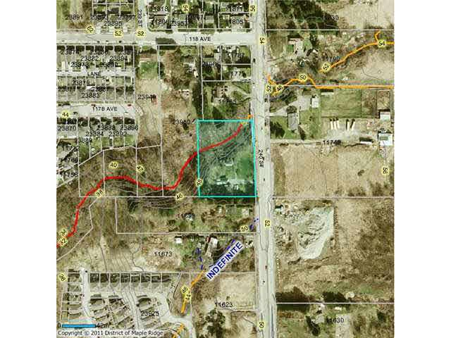 Development property or holding property. Can be sold with neighbouring properties for a total of 6.98 acres slated for aprox 65 townhomes. House is very liveable while development is being completed. Close to schools, parks, Meadowridge Private School. New Townhomes with many on greenbelt Shop and barn on property. Income producing while you develop