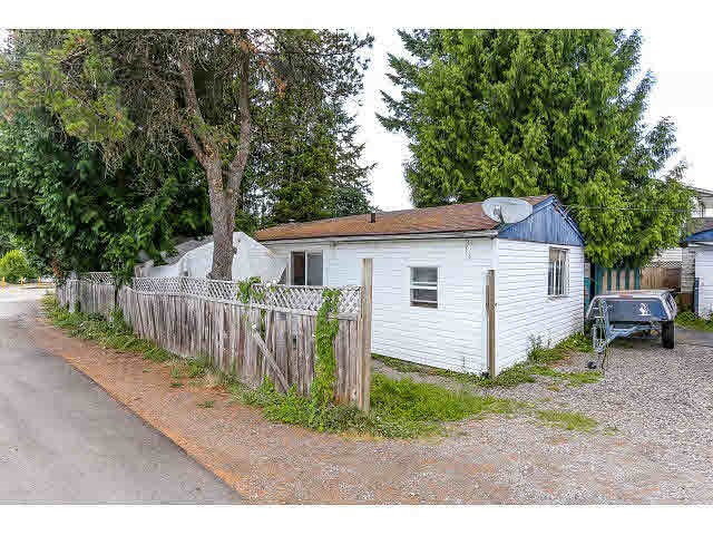 Corner lot 7300 sq ft with 898 sq ft, 2 bedroom rancher house. Great future development opportunity. Possible land assembly. It will be a prime development for townhouses. Lane access & storage sheds. Shopping & transit nearby. A great investment.