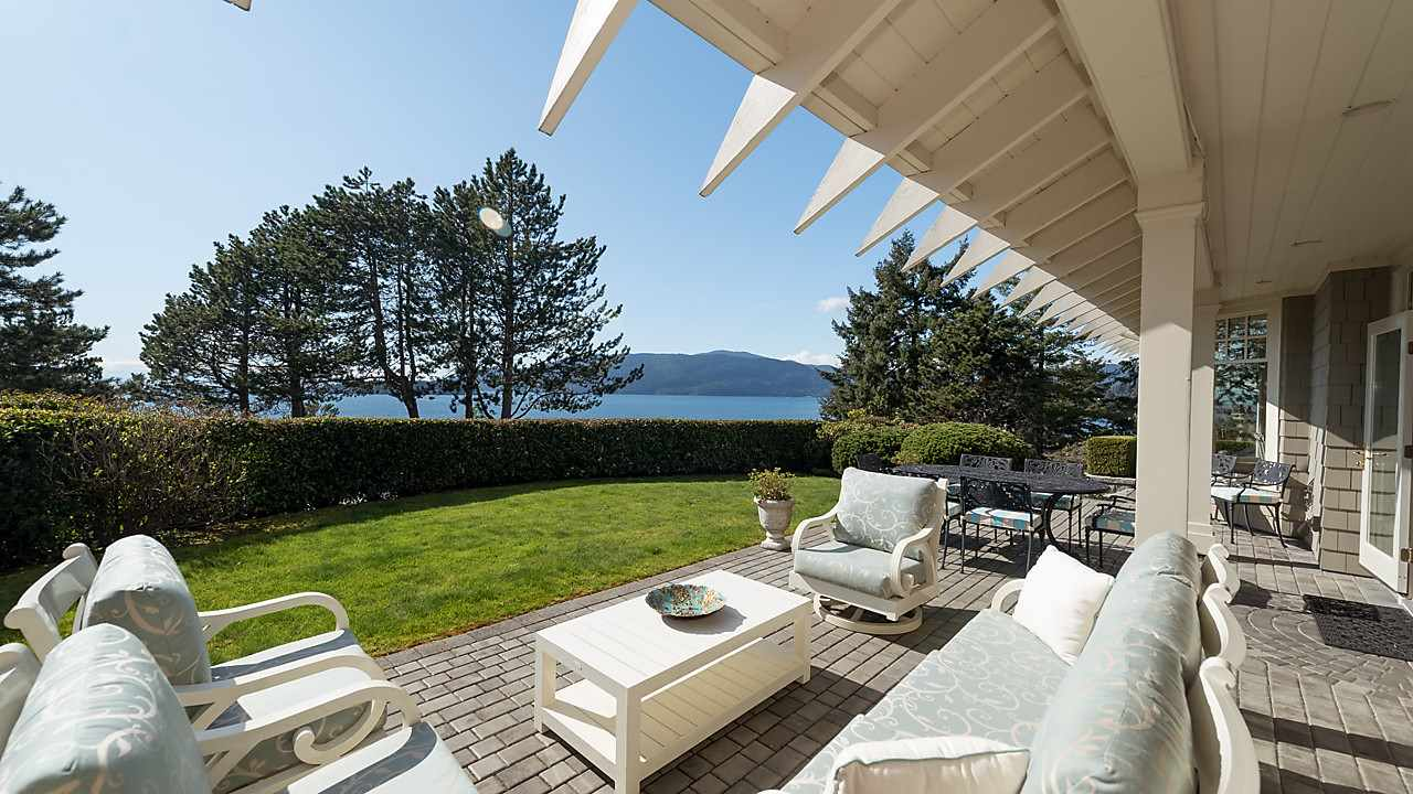 Welcome to Seaside Place. A Waterfront enclave nestled into a quiet cul-de-sac. A true masterpiece of West Coast Arts and Craft designed by renowned Gordon Hlynsky with soaring ceilings and exposed beams allowing a great feeling of space and volume throughout the main level living areas. Enjoy the close intimate views of the ocean, passage & Bowen Island plus Eagle Harbour Marina throughout the practically designed 2 level floorplan with host of features including high-end Sub Zero, Viking & Miele appliances, extensive oak hardwood floors, media room, wet bar plus abundance of custom millwork including wainscoting & double crown mouldings. The home has been meticulously maintained by the current owners with close proximity to the Marina, Gleneagles Community Centre & Caulfeild shops.