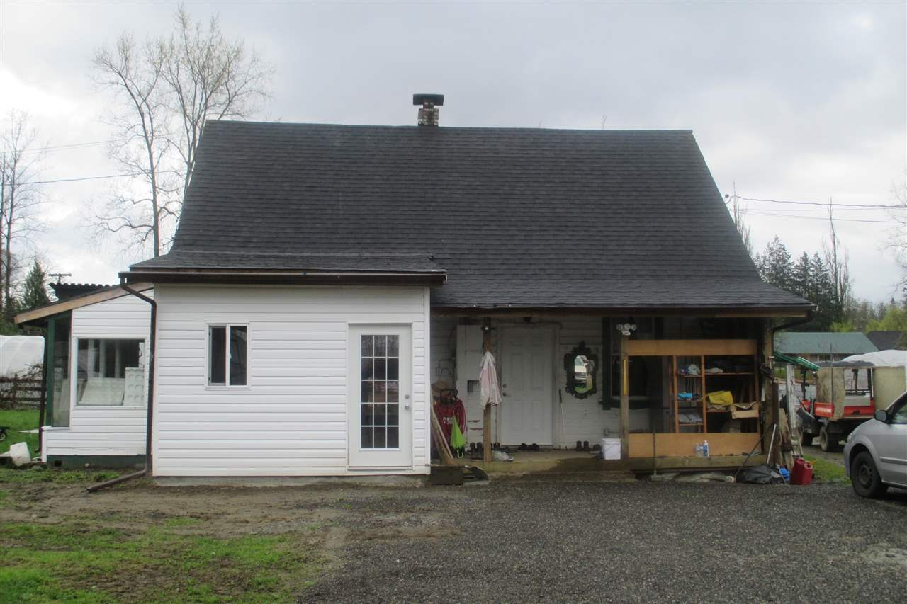 6.81 acres, a rare flat & cleared farmland with 2 houses. 2nd house living space approximately 1,180 sq ft (3 BR + FAM RM + 2 KIT + DIN RM + 2 BATHS). Ideal for small size farming and owner has been running vegetable farming business over 11 years (will be retired). Very nice farming property near town in Maple Ridge. A Must See!