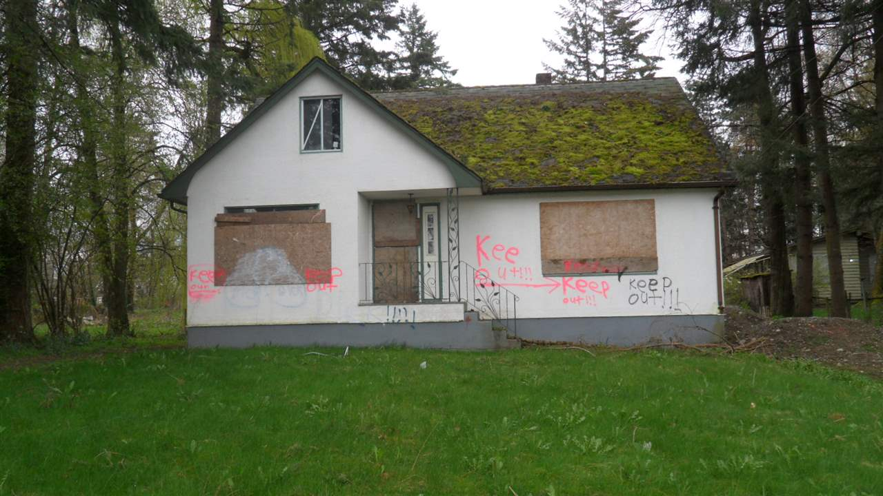 Investors take a close look !! Here is your opportunity to do a great development. Excellant location. Right at the border of Abbotsford & Aldergrove on Fraser Hwy. Across from Shell Gas Station & Starbucks. OCP shows commercial. Lot size 72 x 211. Total 0.37 Acres. Make your Rezone inquiries at City of Abbotsford for different options. May be a Gas station, Bank, Tim Horton, Subway etc. Property next door is also for sale. Both properties can be sold together. House needs lots of renovations. Can be a good rental. Not rented for some time. House is of no value. Call  for more info.