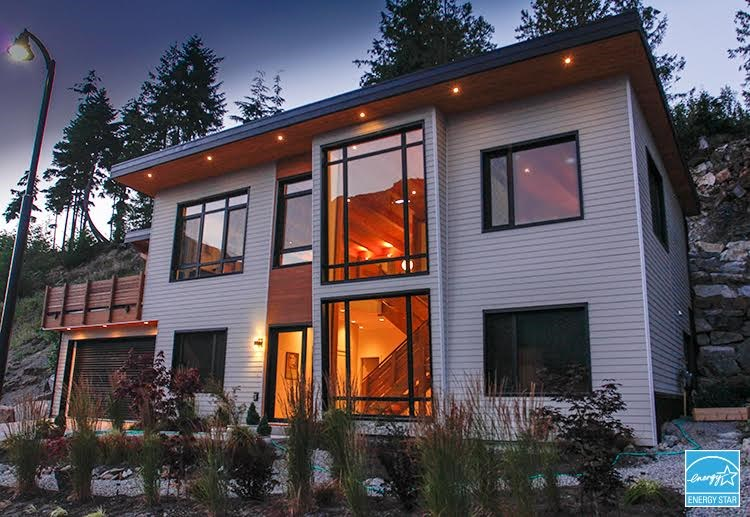 """STUNNING timber frame home takes design inspiration from mid-century modern times. Coastal Douglas fir timbers frame the melange of interior cedar wood paneling & concrete, a brick fireplace, cream kitchen, covered deck area, floor to ceiling windows soaking in the amazing views of Howe Sound & surrounding mountains; just some of the great style features of this West Coast gem. First-to-certify """"ENERGY STAR"""" home in the entire Sea to Sky corridor (Energuide rating 95.3), built under Home Pacific Warranty program (to 2024). Advanced construction technology w/only natural & renewable building materials to ensure a healthy home environment. Premium HRV system circulates fresh air hourly; inexpensive in winter, comfortably cool in"""