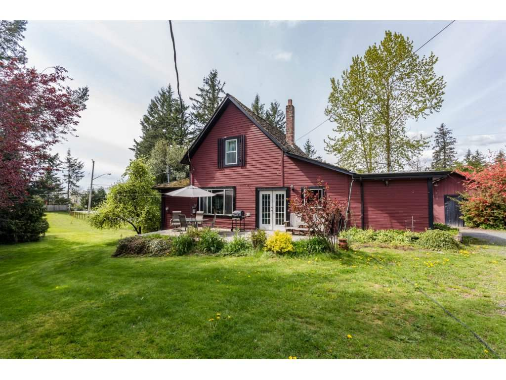 Builders & Investors Alert!! Desirable location on the Aldergrove/Langley Border. A few outbuildings, 30 x 80 Workshop, 12 x 20 Storage shed and 16 x 10 Root Cellar. Please check with the City of Abbotsford in Regards to Development Potential. Well cared for home has many updates including hardwood floors. The Property and Improvements is being sold as is where is. Please do not walk on the Property without confirmed permission.