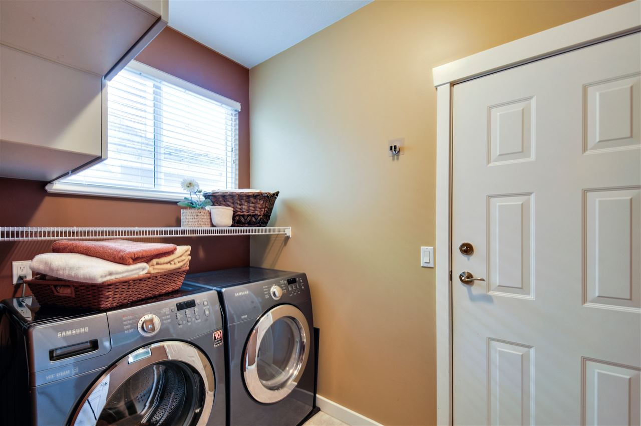 Laundry Room on the main floor, clothes washer & dryer 2 1/2 years old