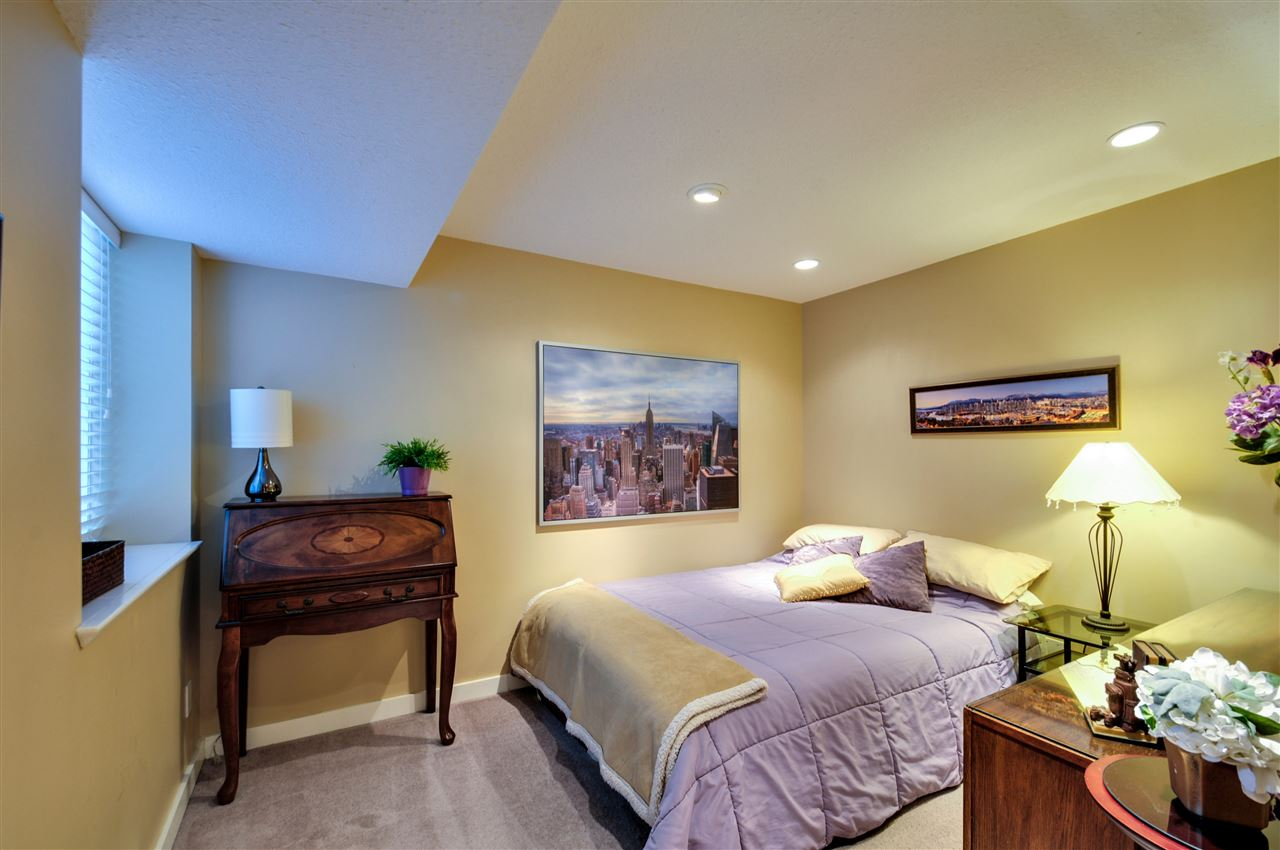 """Bedroom 11'3"""" x 8'10"""" downstairs for upstairs use, could possibly add a door to join this room to the suite, to make it a 2 bedroom suite"""