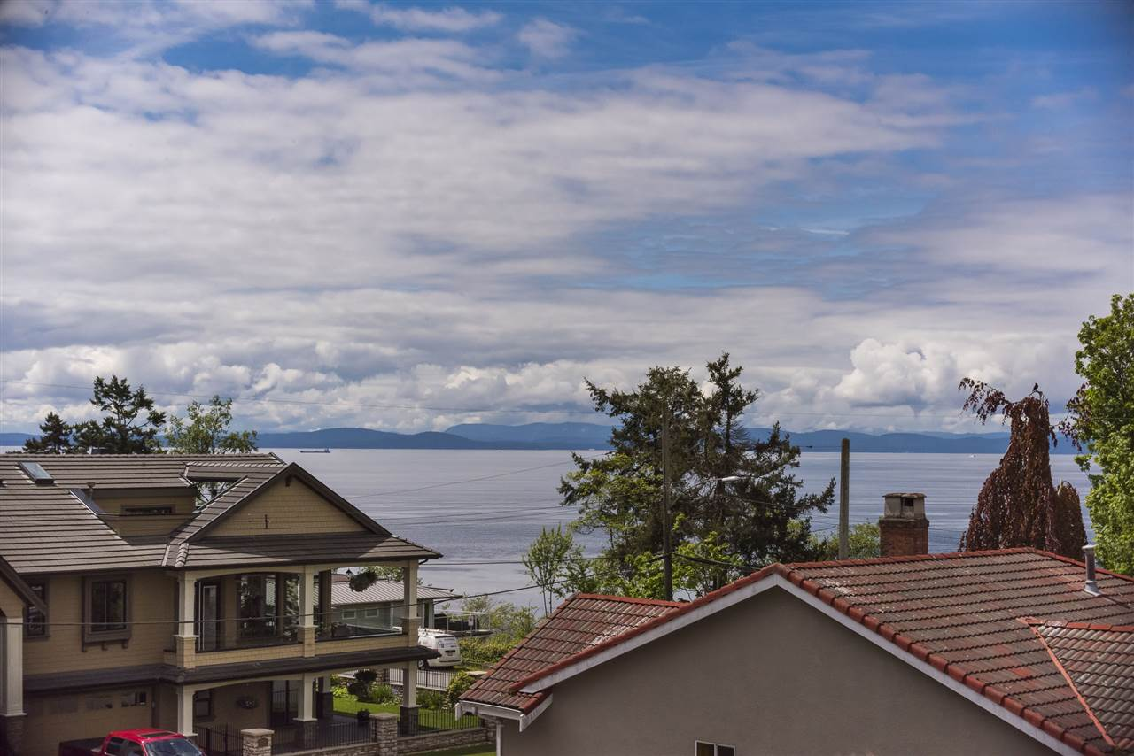 Fall in love with the incredible Ocean and Gulf Island Views from your private roof top deck! Situated on Tsawwassen's PREMIER street, this 4 bedroom, 2016 built home features nearly 2,800 sq.ft w luxurious finishings throughout. The kitchen is a chef's dream w a 5 burner gas range & pot filler, wall oven & microwave, motion sensored faucets & built in wine fridge! Entertain in your open floor plan that leads out to a beautiful back deck w western exposed sun drenched fenced yard. Upstairs the spacious master bedroom boasts two walk in closets, a stunning ensuite & a private deck with a water view! Other features incl Air Conditioning, Hunter Douglas Silhouette Blinds, In Floor Radiant Heat, plus balance of 2-5-10 year warranty! By private appointment.
