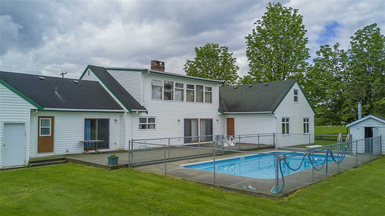 5 (flat) acre HOBBY FARM, close to town! This 4000+ sq.ft. home has room for the whole FAMILY! HUGE Livingroom, Dining room, Kitchen, Eating Area, Family Room(gas f/p), Laundry, Main Bath, Powder Room PLUS 4 Bedrooms on the 2622sqft MAIN FLOOR! Both the Eating Area (can seat 6 comfortably) & Family Room offer access to the 34x16' INGROUND POOL(fenced)! Upstairs is the Big Master Bedroom Retreat, Office & ginormous Rec Room. This home offers tons of closet & storage space too! Semi-circular driveway with Extra-large, side entry, attached 27x23 DOUBLE garage. There is a 52x35' BARN & a 80x60 Coverall structure suitable for cows, goats, horses etc..depends on what you need? Property is fully fenced & cross-fenced, pasture to the west.