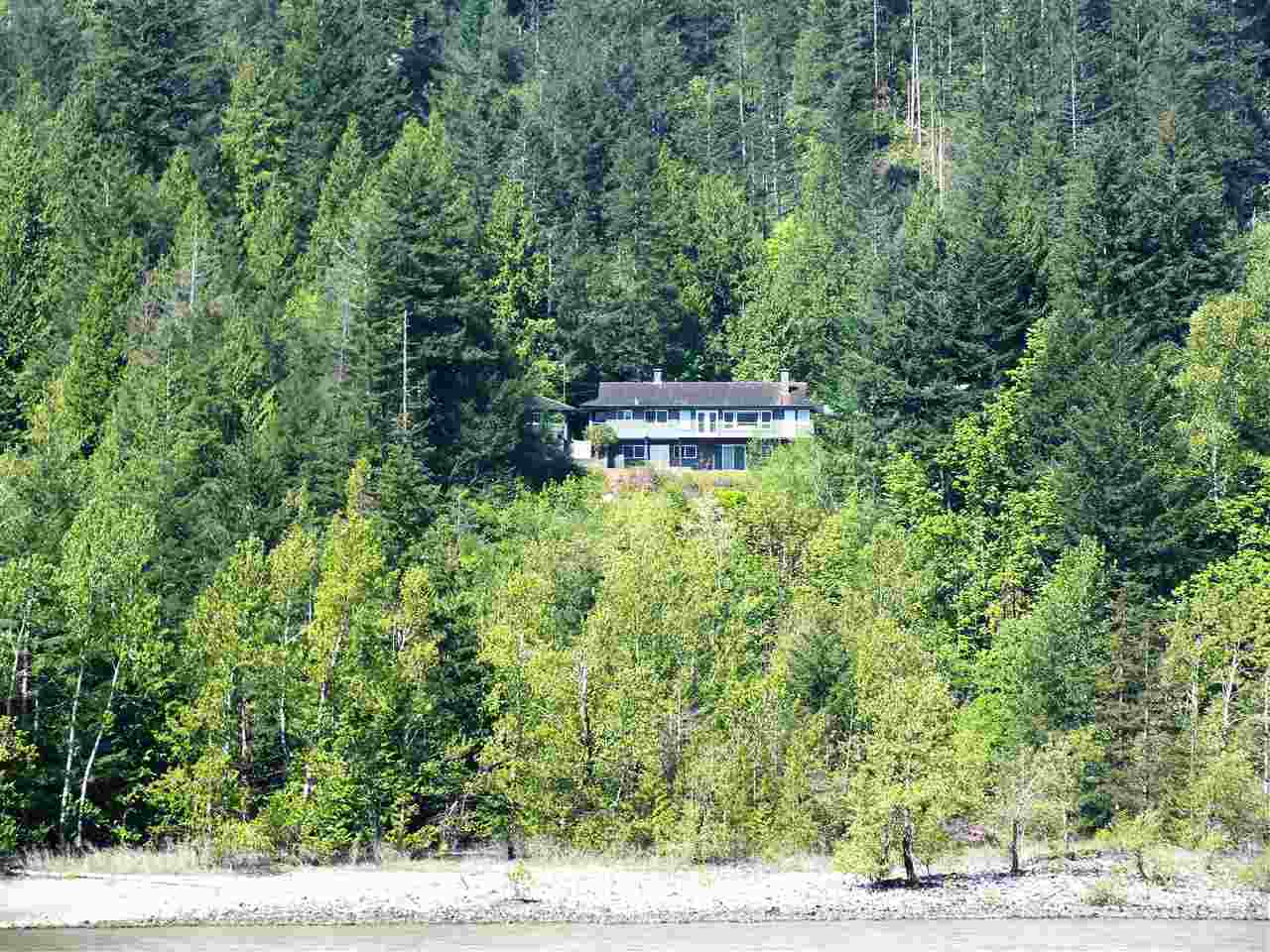 1430 sq. ft. rancher w/ full walkout basement on 2.68 acre river front lot. Home perched above spectacular Fraser River and enjoys world class views of surrounding valleys & Town of Hope as well. Detached single garage, 28 x 32 industrial shop, large garden area & plenty of yard all on this one of a kind beautiful property. Enjoy Salmon fishing just out your back door.