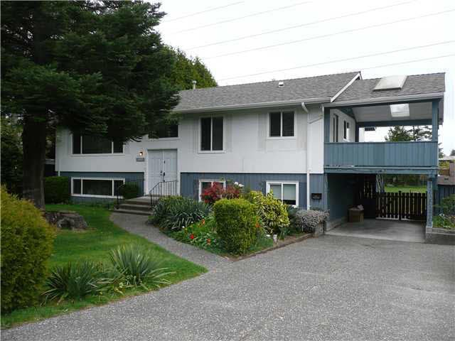 Great investment, 2 level home on 19,785 square foot lot. Main floor has 3 bedrooms, updated kitchen, bathrooms, 5 appliances and refinished hardwood floors. Lower level has two bedroom and den legal suite with it's own laundry! Other upgrades include electrical and plumbing. The roof is also only 11 years old. Great location close to all amenities as well as both levels of schools. Please call LS for your appointment to view. Both levels of this home are currently rented. Note: BC hydro high voltage wire above and through the backyard.