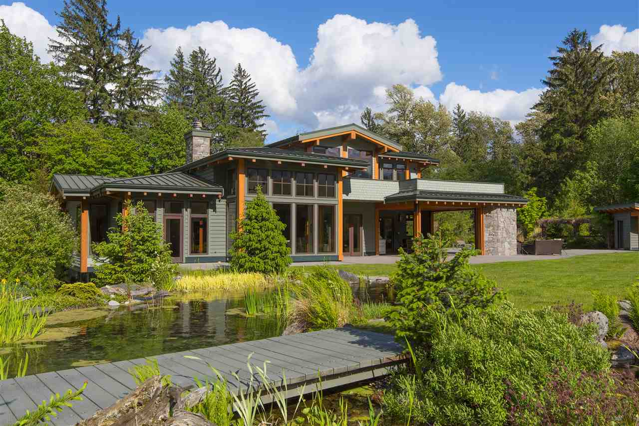 Spectacular gated Riverfront Estate designed by Georgie Award winning Jamie Martin Designs, offering complete privacy & the most breathtaking West Coast setting imaginable! Surrounded by towering snowcapped Serratus Mtns & Mt Garibaldi situated along tranquil shores of the Squamish River offering a dramatic open flrpln w/approx 6050 sqft incl 5 bdrms & 6 bthrms. Exquisitely appointed, feat lg picture windows & stunning finishings incl massive Basalt F/P, timber-framed constr, milled fir & slate tiled flrs. Vaulted master suite graces entire upper level. Gorgeous Chef?s kit, dual granite islands, incl brkfst bar & Butler?s pantry. Covered O/D patio w/stone F/P, BBQ & wet bar opening out to a sparkling salt water pool & hot tub surrounded by lush manicured gardens. A World Class Estate!