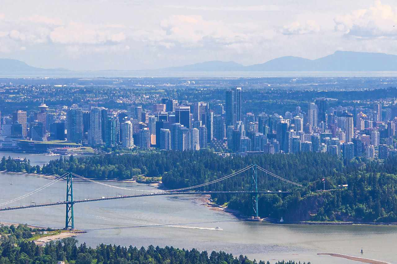 INCREDIBLE VIEWS of City, Lions Gate Bridge and Burrard inlet from all rooms on main floor and upstairs. This luxury residence offers: 6 bedrooms (5 ensuites), 6 baths and powder room. Top quality throughout - maple hardwood floor, granite counter, gourmet kitchen, plus wok kitchen, air conditioning, great media room, wet bar, sauna. Wonderful outdoor pool for your enjoyment. Beautifully landscaped gardens with waterfall and pond. Gated driveway for privacy.  Bring your decorating ideas.  Located in great neighbourhood.