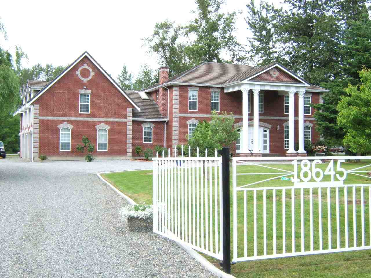 West Clayton NCP Area. Attention developers and investors. SPECTACULAR. High privacy hedge & gated drive to MOUNTAIN VIEW 2.5 acres & STUNNING GEORGIAN COLONIAL built by European craftsman. 40x26 heated garage w/10' doors. 59x16 building w/workshop & 2 stall barn. RV storage 24x20 w/11' ceiling. Tile roof, brick exterior, 2x6 walls, silent floors, hot water heat, 10' ceilings, HRV system, gazebo & patios. GOURMET Maple kitchen w/SUB ZERO, walk-in pantry & wok kitchen - open to family rm. Den or 5th bdrm. Over garage - huge games rm plumbed for wet bar (excellent nanny suite). Master w/balcony & f/p to deluxe ensuite. Fantastic investment. Can be purchased with neighbouring 2.5 acres - 18619 74 Ave MLS# R2168129 for a total of 5 acres.