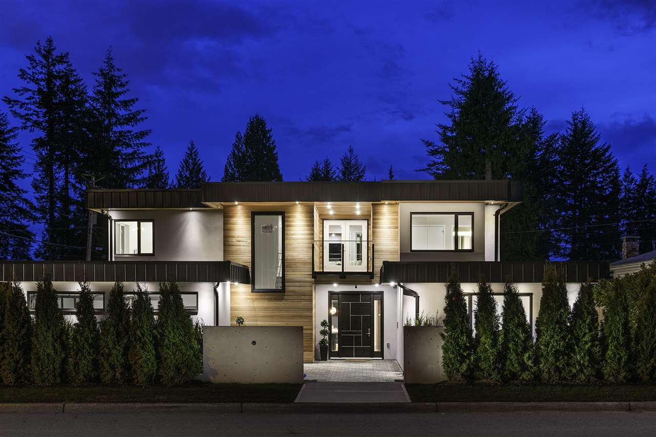 """Custom built home right in the heart of Edgemont Village. 5500 SF of modern luxurious living on a prime 80'x115' 9200 SF lot. North shore mountain views. Highlight include Miele appliances throughout kitchen, Subzero dual temperature wine cooler, Control4 smart home automation, security and surveillance with 8 buildin cameras which can be viewed remotely, floating LED backlit staircase, Dimmable LED lights thought out the house, in floor radiant heating, AC & HRV system, deluxe home theatre with 120"""" screen. Spectacular outdoor covered living space with a custom built cascading water feature. Walnut veneer and calcatta stone feature wall, Caesarstone countertops, solid wood cabinetry, engineered hardwood flooring, central vacuum, and option of backup Generator and electric car charge."""