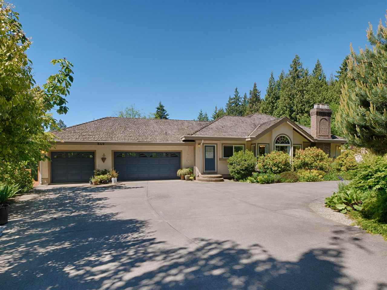 Fabulous 6000 sq ft. house perched high on a gorgeous estate-like property located a short drive from the Vancouver ferry. Enjoy entertaining friends and family from your exquisitely well built, ultra-spacious level entry home. Plenty of light from the large windows looking out over your 2.47 acre expanse of land & gardens, a spring-fed pond, and view of the ocean and Vancouver Island. Features include a 3 bay garage, second detached and plumbed garage/workshop with 12' ceilings, greenhouse, 400 amp service and much more. Surrounded by trees for complete privacy. Meticulously maintained, the property is zoned for 2 full size homes and subdividable if you choose.  See a live walk-through video by clicking on the Virtual Tour. Live the dream!