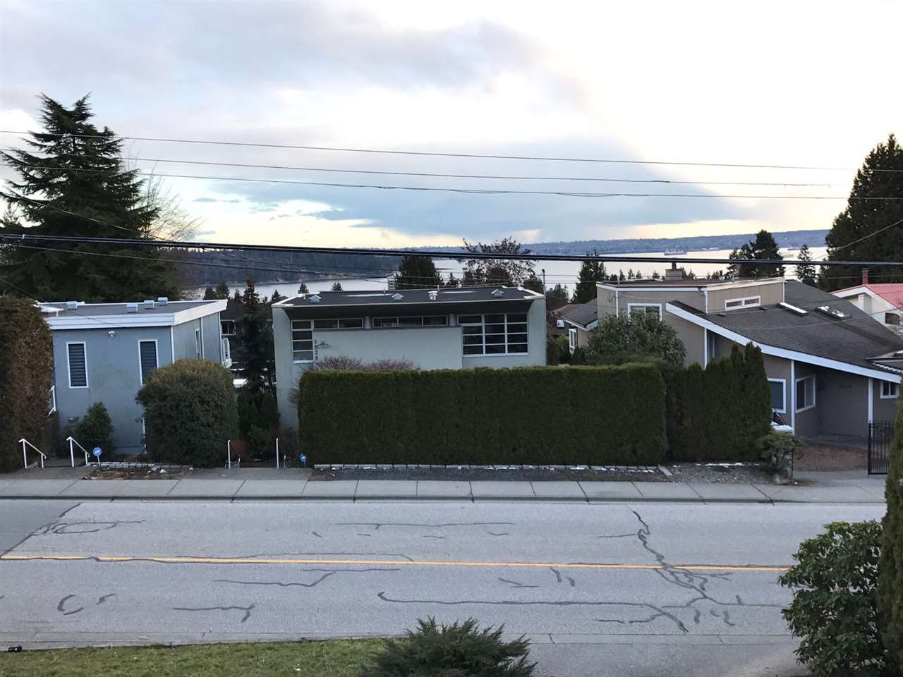 Convenient Ambleside area with city and water view.  South facing beautiful lot with laneway access.  Features include hardwood and slate flooring.  Solid, but needs renovation or plan for a rebuild.  Fabulous location to build your dream house or great holding property.