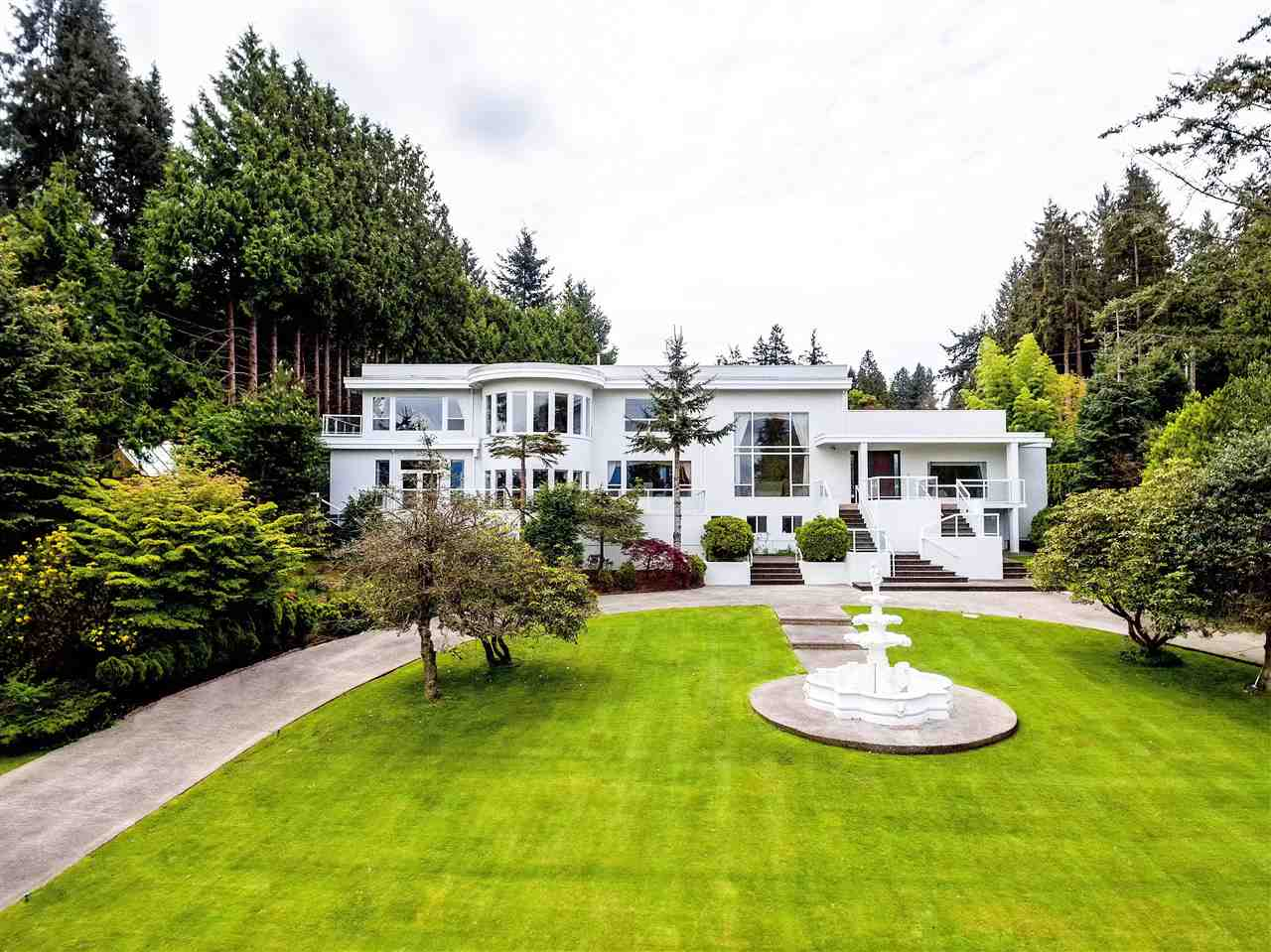 Spectacular Residence. In the prestigious Point Grey area, this residence w/ water & mountain views showcases a huge meticulous front yard & circular driveway. Over 35,500 sqft of precious lot size & over 8,000 sqft of luxurious living. Impressive grand foyer w/ skylights & dble height living room. Entertainment sized dining room & family/media room. Gourmet kitchen w/ wok room & breakfast nook. 2 guest rooms on main. Upper floor has 4 well-appointed bdrms including an enormous sized master suite w/ own office. Indoor pool w/ hot tub & conservatory area. Nanny quarter & recreation room down. Attached 2 car garage & air-conditioning. A short drive to UBC, golf course & beaches. Good public & private school catchment.