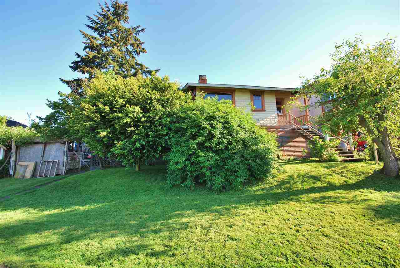 Calling all Architects, Builders & Investors! Amazing water/mountain views of Burrard Inlet & North Shore Mountains! Rare opportunity to purchase two, legally titled, side by side 33' wide lots on Wall St. This property has been in the family since 1940's! Solid original house (non heritage) situated on one 33' wide lot. The other 33' wide lot is vacant. Ideas abound! Build 2 new custom built houses, restore the original house & build one new house, custom build one house on 66' wide lot, hold one lot & sell the other. Great potential here for the right buyer! Maybe purchased with MLS #R2171394 & sold 'as is' condition. No trespassing on property without agent present. Call for your private showing!