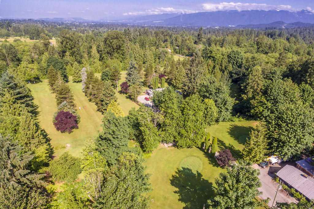 """Hackers Haven""  9 hole 1010 yard  Par 3 golf course set on 10.58 acres. Comes with all equipment and course has a complete sprinkler system.  Currently in the ALR   as a Golf Course. Owned by the same family since 1981. Great business which could be grown.  1654 sqft 3 bedroom  Rancher on the property as well as a barn 60 x 50, and workshop 40 x 50,  Office is 29 x 15 . Located on the corner of 240th and Abernathy way. Opposite is a sub division.  Meadow Ridge school is across the street.  This property has a great future potential.  This business is ready to take over and make your own and take it to the next level.   PLEASE DO NOT WALK ON THE PROPERTY. Showings by appointment only through listing agent."