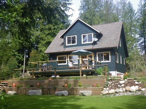 Affordable Roberts Creek home  ! Nestled on almost 5 acres, this 3 bdrm, 2 bthrm  1500 s.f. home is  at the back of the property for privacy, surrounded by natural garden areas, and ready for your creative ideas! It comes with 1 bedroom guest cottage; 2 bedroom mobile; separate workshop; RV site; w. and storage shed, most w. own hydro meters. Rent the whole package for $4400. mth - or live in main house and still have approx. $3000. rental income for your lifestyle ! Picturesque property looking for a loving owner or investor ! Note: separate driveway to keep your privacy while living in the house. or bring your family !!!!