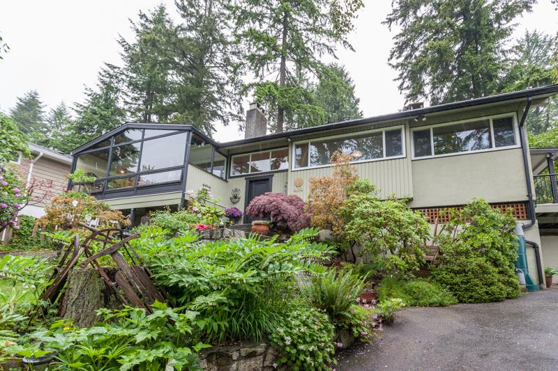 Meticulously maintained and updated bright family home in sought after upper Lonsdale on a quiet North West facing lot. Main floor features three bedrooms, dining room and spacious living room with fireplace opening onto a spacious solarium. A large sun deck off the renovated kitchen, pantry and eating area is perfect for BBQ's and entertaining. Finished lower floor with separate entrance has suite potential and features an additional bedroom, spacious recreation room with fireplace, wet bar, storage and workshop.