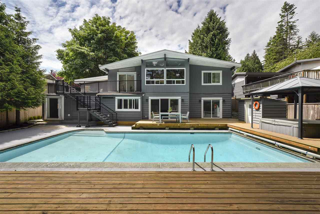 Wow! Fully renovated Tsawwassen residence on sought-after Wilson Drive! This 5 bedroom home sits on a rectangular 8,890 sq.ft lot and offers over 3,300 sq.ft of luxurious living space plus a completely updated walk-out basement that has a bonus 1 (possibly 2) bedroom LEGAL SUITE and an incredibly inviting in-ground concrete pool & covered hot tub. Everything has been updated including new kitchens up & down, new flooring, new well-appointed bathrooms, new lighting, huge entertainers deck, crown mouldings, light fixtures, stone fireplace, modern garage doors, fencing, landscaping and so much more! Large portion of the basement area retained by the main dwelling offers so many opportunities! Just move right in and enjoy this exceptional home!