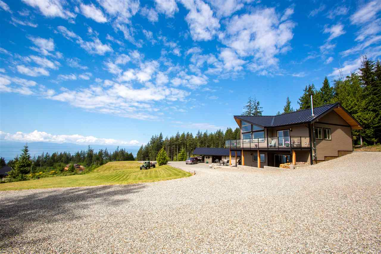 If you have been looking for that private view acreage close to all amenities, this is it. Off a quiet road, the long driveway will lead you to your private estate on almost 5 acres. West Coast inspired design exudes from this large open concept home that soaks in the 180 degree view from almost every room. Perfect for entertaining, watch the boat traffic from your large south facing deck with hot tub, covered for year round enjoyment. Energy efficiency is evident throughout with high density insulation, a metal roof, instant hot water and large windows to allow for natural light. This beautiful property also boasts covered RV parking, a dedicated RV site for guests with water, sewer and power, and a large detached shop big enough to fit 3 cars and is 220 powered for the car enthusiast.