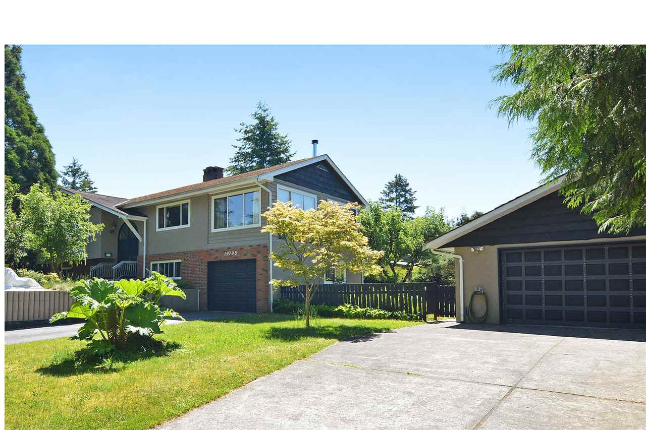 """""""BROOKSWOOD FAMILY LIVING - 11,832 SF CORNER LOT - PRIDE OF OWNERSHIP HERE!"""" 4 Bdrms/3 Bthrms, Bi Level Home w 3000+SF, recent upgrades: Kitchen w Gas Range, Appliances, Windows, and gorgeous Maple Hdwd Flooring up. Delightful Familyrm w lots of windows, and f/s F/place, opens onto Balcony overlooking hedged backyard w water feature, fruit trees and org. garden patch. Fully finished W/O Basement features former Yoga Studio, laundrm, and rm for extended Family. Detached Dble Garage and two Driveways provide lots of parking, w room for RV. Quiet Street in friendly established Neighbourhood, walking distance to School and Shopping, and blocks to Preston Centre, Rink, and langley Fundamental School. Accepting Offers: June 13, 1 pm"""
