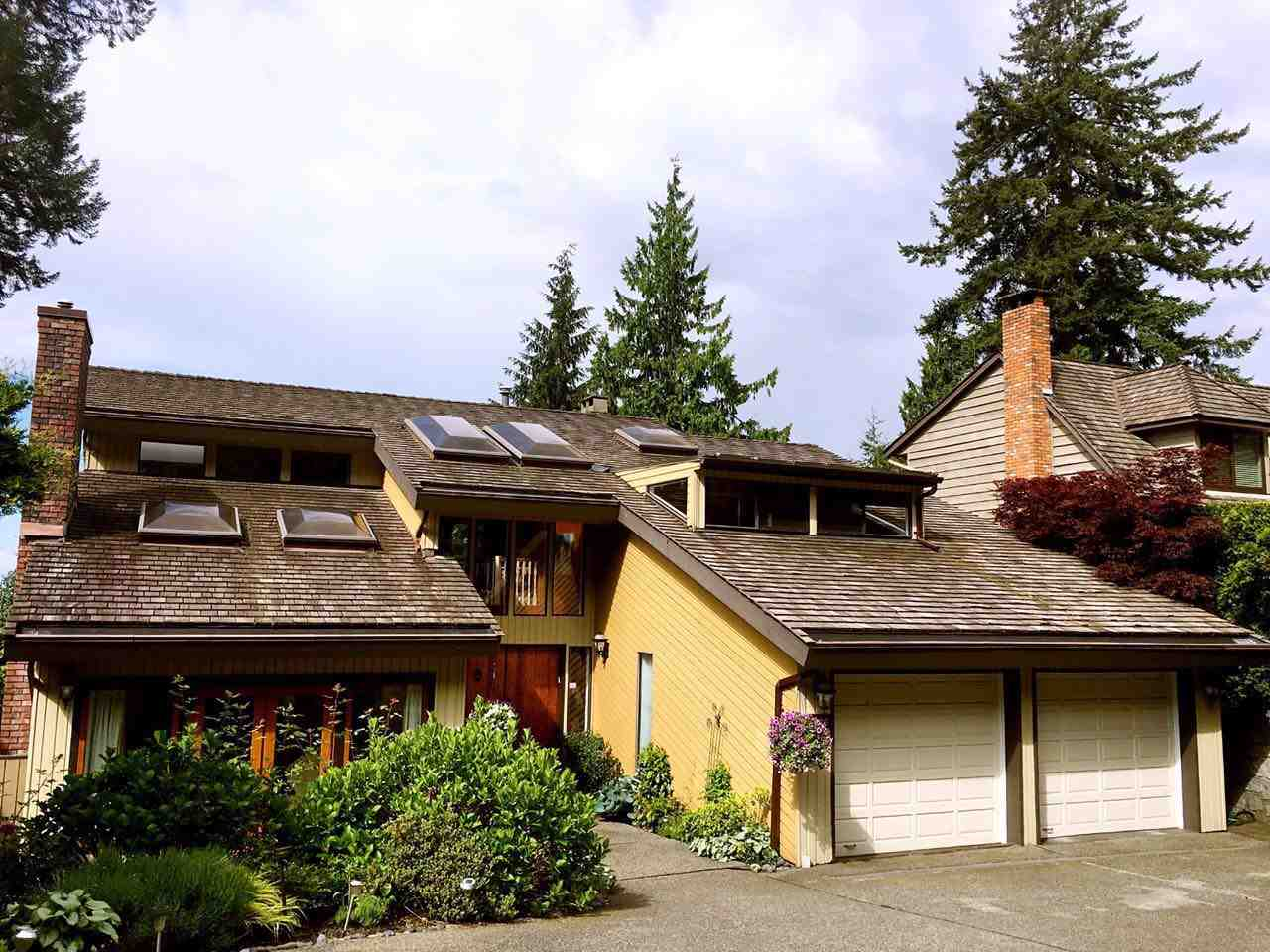Cul-de-sac overlooking private greenbelt! Vaulted ceilings & central spiral staircase. Luxurious private master suite with adjoining sunroom/sitting room. Open plan main floor with large principal rooms, 2 fireplaces, updated kitchen/family room opens to entertainment size VIEW Sundeck. Main floor guest bedroom & bathroom. Lower garden level is a teenage dream with over height ceilings, games room, recreation room with fireplace, snack bar and studio suite size bedroom and tons of storage. Many updates include: euro windows, Brazilian hardwood floors, kitchen updates, tile floors, stainless appliances, mouldings, heated floors in kitchen & bath. Open Sat.Sun. Sep30, Oct1st 2-4pm