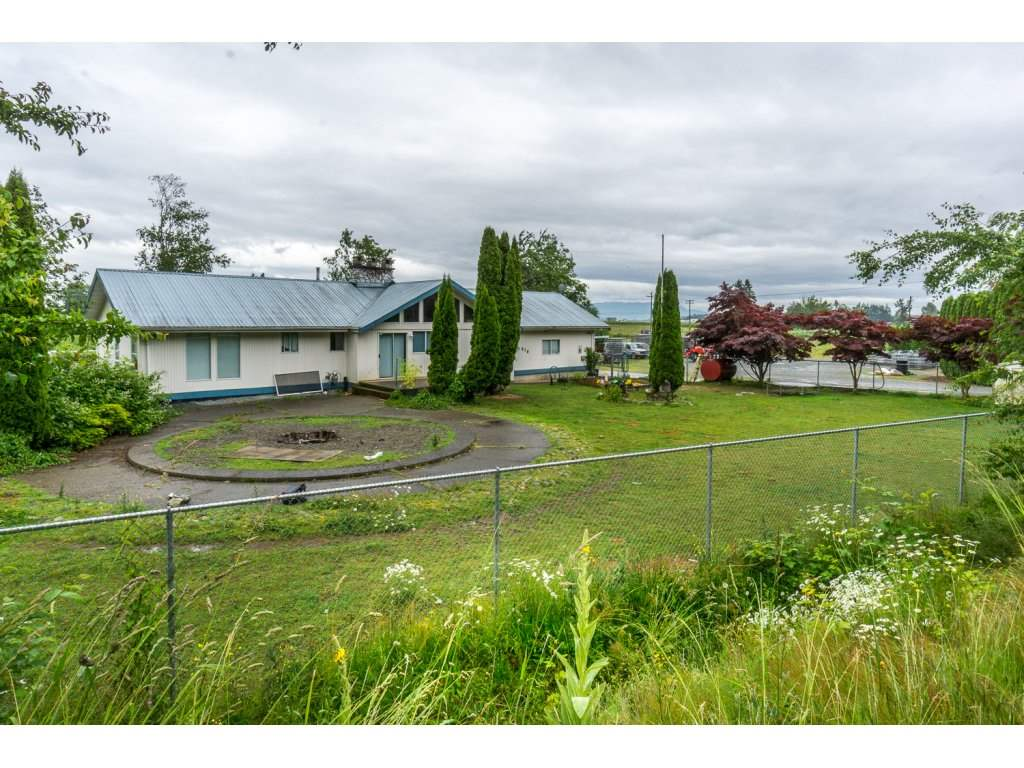 4.4 Acres with two Road frontages close to Abbotsford Airport and Hwy #1. This is a unique property with operating truck cleaning business. Nice home layout just awaiting your ideas for some reno's! Large shop with office. Loads of parking! Lots of potential! Call Kyle Today!