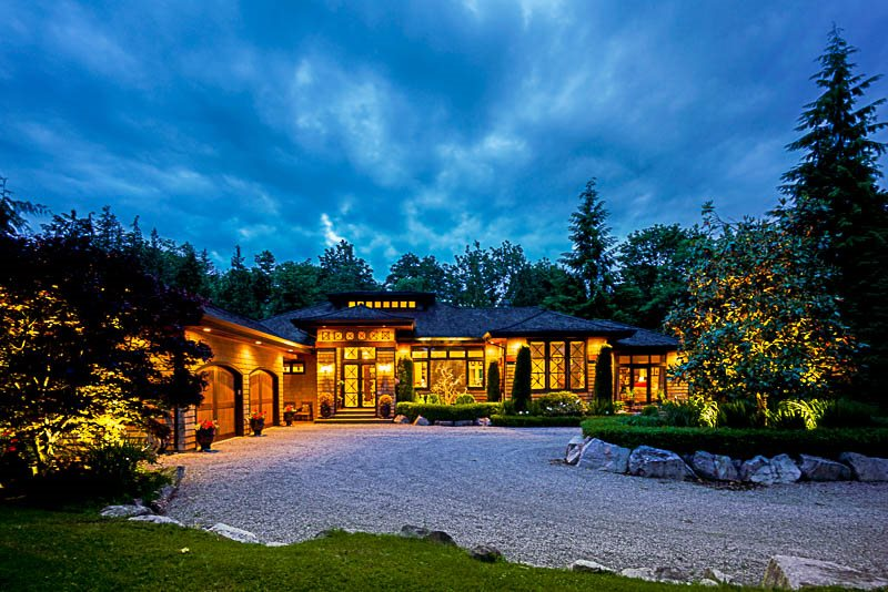 This spectacular custom residence, situated on a gorgeous 2.5 acres, offers complete tranquility & total privacy 65 kms from downtown Vancouver. Beautifully crafted with exclusive use of clear cedar, this timeless masterpiece has just under 7,000SF of living, on 2 levels. Exquisitely designed with spacious living & dining areas. The elegant kitchen is complete with gorgeous cabinets,granite counters, a commercial range & a 10' centre island. The lower level will provide hours of family fun featuring a gym, dry bar, billiards area & family room. Extensive covered patio is wonderful for year-round entertaining. Lutron Homeworks allows you to control heating & music from your smartphone. Heated and cooled by environmentally friendly Geothermal. This rare beauty cannot be replicated.