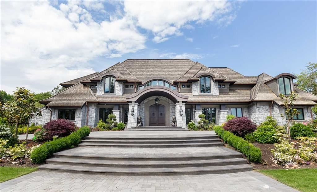 Magnificent Estate Residence sitting in Panorama Ridge also known as the  Shaughnessy  of  Surrey. This  area  is  quiet  and prestigious  with house  facing  South  and  having  views  of  Ocean, Rich  Greenery, yet  location  is  Central  as  Highway 10 provides quick access for commuting to Border (10min), Downtown (25min), Airport (20 min) and Southridge Private School (10min). This Castle-like Majestic home starts with 10ft high solid mahogany Front Door which sets the tone for a Grand Entrance, and immediately the Luxury begins to unfold with the Stunning  Front  Foyer,  Regal  Great  Room,  next  to Gourmet  Chef  Kitchen,  Outdoor  Pool  & Guest House, indoor Theatre/Yoga  Room,  8 master  bedrooms,  10 Full & 5 Half Baths  and  3  Kitchens.  True  luxury Living!