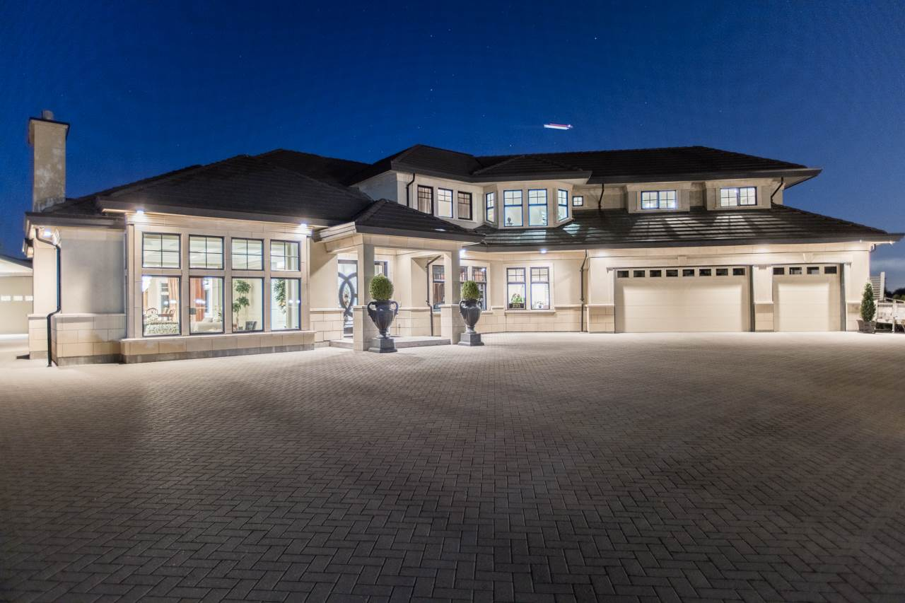AMAZING luxury home located at the end of a cul-de-sac and backing onto Mayfair Golf Course. Sitting on a 71,003SF lot (1.63 Acres), the house is absolutely exquisite . Features include extravagant 500 lb solid mahogany doors on a German track system, enormous 8'x9' entertainment island, walk-in freezer, hand-painted ceiling domes, self-lowering chandeliers, zero-settlement driveway, invisible gutters, QuietRock sound-proofing, invisible gutters, outdoor dining and kitchen including BBQ & fire place, hot tub and koi pond with beautiful landscaping including rose garden plus much much more. Don't forget the golf course view and unobstructed North Shore mountain views!