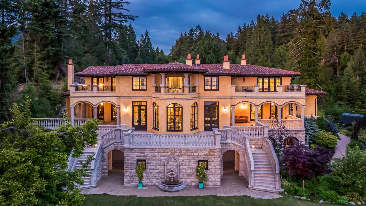 ONE OF A KIND IN CANADA. Experience ultimate privacy on this 2.3 acre European inspired estate in one of British Columbia's most sought after locations, West Vancouver. This property was built over 5 years, sourcing the finest materials from all over the world. The property co-exists with it's supernatural surroundings, embracing the natural rock waterfall at the entrance which is also incorporated in the underground wine cellar. Sit back and experience breathtaking sunsets, expansive ocean views, and watch the sailboats pass by. The entrance to the property is out of a fairy tale. The tall electric gates open to reveal a stunning courtyard reminiscent of a museum in Europe. These meticulous details must be seen to be appreciated.
