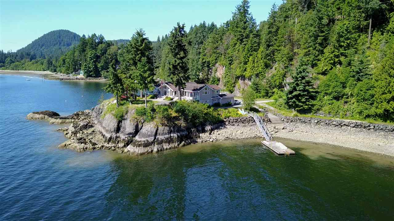 If you are looking for something remarkable, come view this exceptional waterfront acreage.  This 2.5 acre parcel with 4 bedroom gracious home is unparalleled and so close to Vancouver.  Property is absolutely perfect: gorgeous updated home, concrete boat launch, level areas all around for patios, parking & yard, and private bay with deep moorage at your doorstep.  Potential for a 30 ft high boat house. There is an unbelievable 900 plus ft of water frontage so home is almost surrounded by ocean.  A peaceful & relaxing retreat, this home is made for easy entertaining with the games room, media centre, 2nd kitchen & bar area in the walk out lower level.  So convenient at just 2 minutes from the ferry and 6 minutes to Gibsons.  You'll feel very lucky to call this home and property your own.