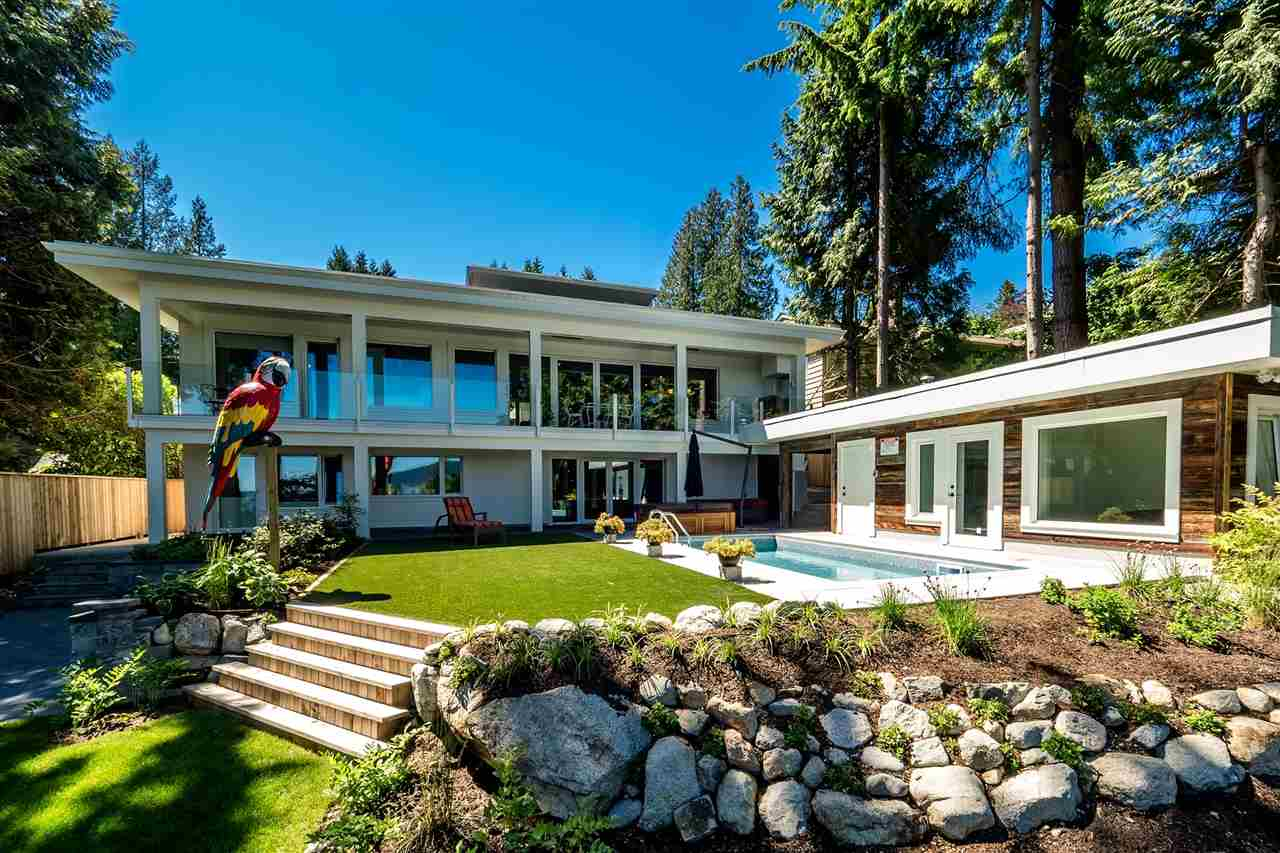 North Shore?s first Certified EnerPHit Passive Home. Offering a flash from the past where old meets new. Effectively rebuilt in 2016, but NO GST is applicable, this 4300 sq foot, 5 bedroom home offers both a cozy family atmosphere combined with a modern open contemporary plan. A true entertainers dream. Both privacy and bang on views to Mnt Baker and SFU, with features that include granite counter tops, high end appliances, custom cabinetry, oak hardwood floors, Euroline windows & doors and antique fixtures. Inground pool w/ cabana and a separate 1 bdrm Nanny suite. This house is not to be missed. For further technical details on passive homes and features about this home please refer to the listing attachments. GRAND OPENING  Saturday and Sunday  June 24th - 25th 12 - 4:30 pm