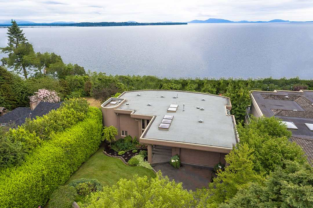 Exclusive Waterfront Executive Estate Residence in White Rock at 13976 Terry Road. Panoramic Pacific Ocean Views and Sunsets, view spans South, West and East. 26,500 sqft. lot, rectangle shape. South Frontage 76 feet and the Depth 345 feet (.61acre) Professionally landscaped 5 Bedrms & 31/2 bath, total 3968 sq.ft. Hardwood floors, curved open staircase, Master bedroom suite on main floor 400 sq.feet. Walk out lower floor with four more bedrms, media & family room. South facing balconies and grassed backyard all enjoy sensational views. Very tranquil, central location. Beach access 7 homes away @3.5 acre City Park Coldicutt Ravine. School catchments are Bayridge Elementary & Semiahmoo Secondary.