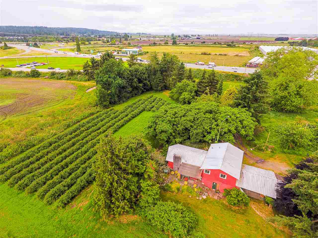 First time on a the market in 75 years! Incredibly rare and highly coveted 90 acre parcel in strategic location close to Hwy 99, US Border and just minutes to major South Surrey & White Rock developments. Incredible investment opportunity here! Potential for large scale agri-business. Current property contains an occupied farm house and barn. Do not disturb owners or enter premises without permission. By private appointment only. Contact listing agent for more details. Foreign purchaser tax not applicable.