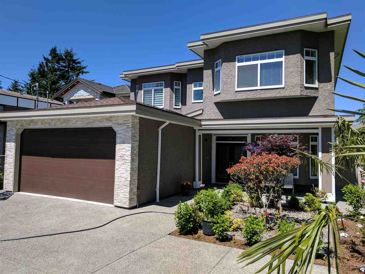 Beautiful spacious 3500 plus SF home situated on a 7200 SF lot. Enter the South facing front entrance into a 19' high foyer. Up the metal spindle stairway to the main flr w/10' ceilings. An open living/dining area w/gas F/P greets your guest. Into the open kitchen, nook & fam rm. There's also a convenient spice kit & a covered deck great for BBQ's. Master bdrm boast walk in closet & ensuite w/double sink & 2 person jetted tub. 3 additional bdrms on the main w/2 sharing a 3rd bath rm up. Luxury touches incl AC, radiant flr heat & HRV system, granite countertops, thick crown moldings, pot lighting, security cameras, both gas & electric cooking. Legal 2 bdrm suite down w/high income. 9' ceilings on this level with Den, hobby & rec rm; possible 2nd suite. Double garage w/handy workshop area.