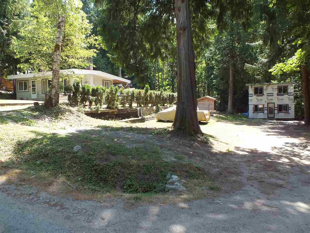 Amazing opportunity just steps from beautiful Kawkawa lake. This beautiful property has great future potential as well as immediate use. Situated on a large .36 acre lot this property features a solid 2 bedroom 1 bathroom rancher as well as a partly finished bunkhouse with loft and bathroom. Excellent opportunity to hold as a recreational or development property. RV hook ups on site. Use as a shared family get away or full time living. Live on site now and build your dream home in the future. Or subdivide into 2 lots once the city gets water to this road. So many options for this gorgeous property. Large covered deck. New roofs. Lots of outdoor space for family activities. Close to boat launch for fishing and water sports.