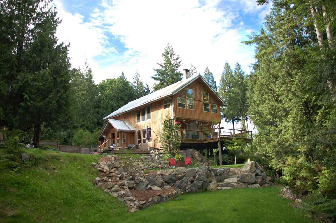 Designed and built with family in mind, this 2.23 acre property borders Crown Land and the forest of Mt. Gardner. Sunny mountain views, fruit trees, exterior decks, with fire places and a hot tub ensure a cozy place to enjoy the tranquility. 4 Bdrms, 2 baths in the main house include a master bdrm with its own private deck. Open plan LR DR and kitchen and lofted ceiling to the bedrooms and family room above. Large separate workshop/studio with fully equipped guest suite. Fenced in garden will keep kids in and the deer out. Steps to Killarney Lake and Mt. Gardner trails. Proximity to the Cove and ferries is an easy commute. Huge yard and forest property make this a magical and healthy place for kids to grow.