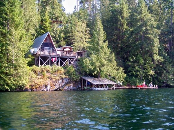 "Sakinaw Lake .527 Acre Property with 100 feet of waterfront. Easy road access and electricity. Two separate buildings- an original 4 bedroom ""A"" Frame cottage (830 sq.ft.) and a stunning (2006) studio, (565 sq.ft.) Both buildings have spectacular lake and mountain views, multiple sundecks, walkways, wood flooring and fireplace. The lakeside boathouse and two moorage docks facilitate your water access for swimming and boating. Year round family enjoyment at your lakeside home."