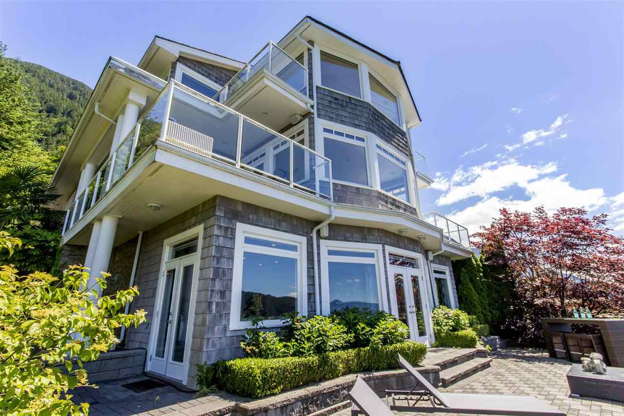 A special waterfront home located in a special waterfront community.  Ocean Point consists of an enclave of executive waterfront homes with an outdoor West Coast feel, shared boating facility and tennis court.  1 Ocean Point was rebuilt in 2010 and designed to entertain with its open oval entry that leads into the living area with endless views of the Howe Sound, Islands and access to exterior decks on either side.  The gourmet kitchen on the main floor is of open concept with high end appliances and access tot he large entertainment patio terrace.  A media room is also situation on the main floor as is a den.  Relax and lay back while taking in the tranquil settings of the Howe Sound in your luxury Master Suite.  A must see.