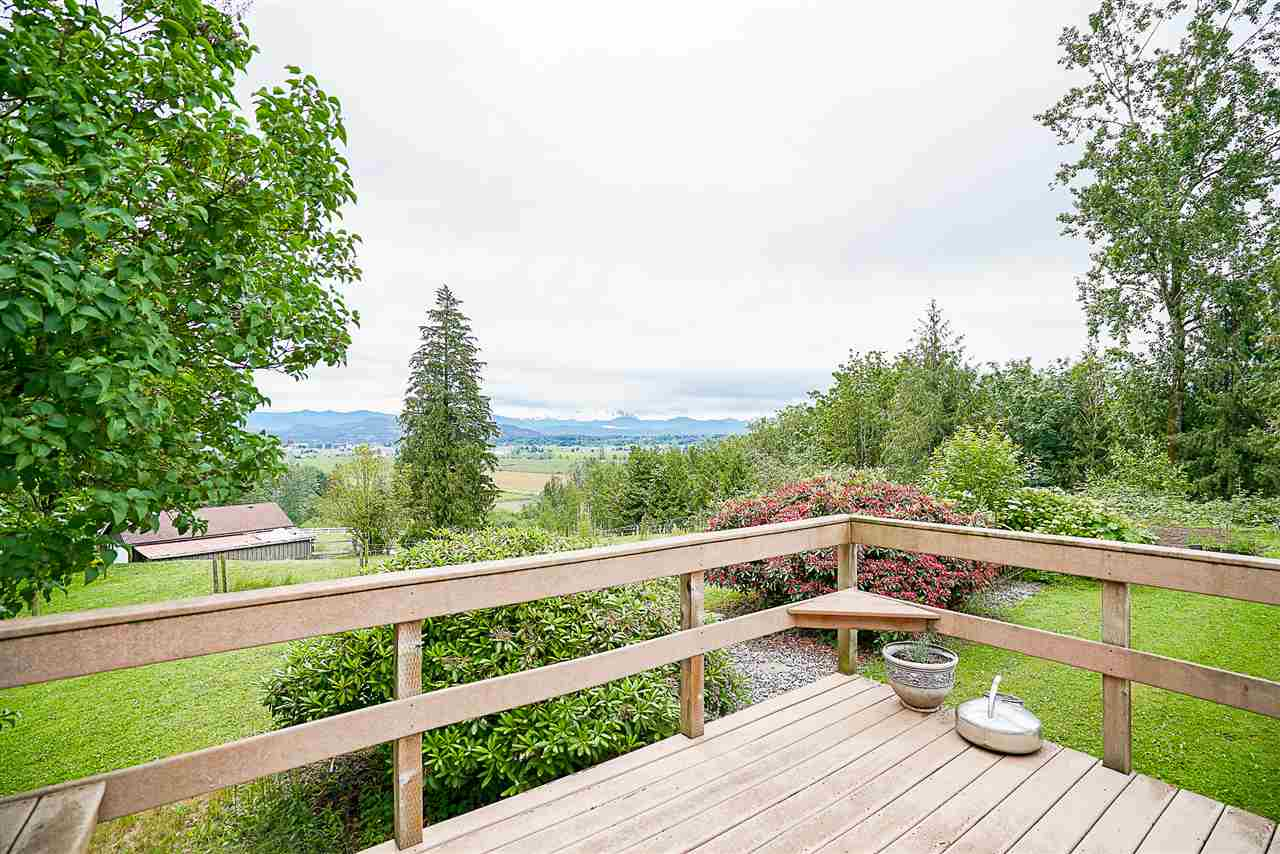 People wait a long time to find view properties like This! 39.31 acres right along the Ridge on the Eastern Mt. Lehman border with spectacular views of Mt. Baker and the Matsqui Flats - build your dream home, plant your crops and gaze your animals on this sprawling & exclusive piece of property. Location is key when choosing your estate property and you won't find better than this with its quick access to Abbotsford and the freeway! The current home has been updated throughout with an impressive deck & unobstructed view of the valley! Four bay machine shop, horse stalls, riding arena, loafing shed in the field and many trails around the property for you to take in nature's beauty - call today for your personal guided tour.