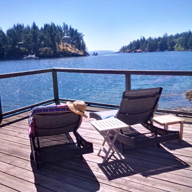Extraordinary Development Waterfront Acreage or Family Estate. Private 5+ Acres is forested down to the shoreline along Bargain Harbour, with an easy grade drive winding throughout. Country Chic 1800+ sq.ft. VIEW Cottage with Loft is tucked into the trees & boasting views overlooking Bargain Harbour. Excellent Hyde-Away while your waterfront dream home is revealed at a choice of build sites along the seashore! A natural outcropping forms the perfect breakwater siting for the pier and beach area, offering shelter for a future dock. 590 sq.ft. Maritime shed sits at the shore... uses are limited only by your imagination! This is an incredible Oceanfront/ Beachfront acreage with moorage potential that will not disappoint. GST applies to a portion of land.