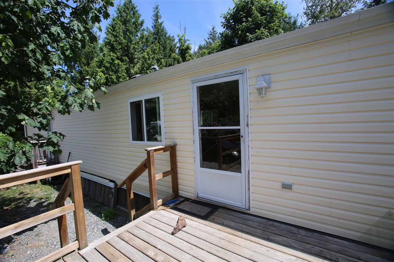 Newer manufactured home on a rare beautifull private location. Surrounded by trees and plenty of yard space and gardens. Pad rental is only $350/month and includes a large private yard area with a 10 minute drive to Sechelt shopping and beach, etc. This home has a vaulted ceiling, 2 bedrooms, open plan, Sundeck area, garden pond and more, on private treed land. This is not a mobile home park.