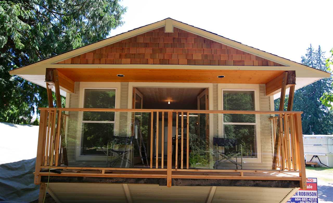 Completely rebuilt manufactured home in the Ponderosa Pines Park, located on the best spot over looking Chapman Creek with large park like setting and private yard just 1 block from Davis Bay Beach. This home has a large 15 x 17 living room, cedar ceiling, open plan, covered sundeck, gas stove, wall oven 2 x 6 construction and more.