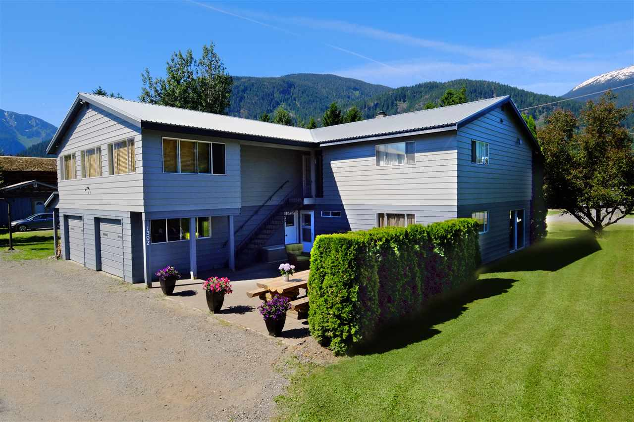 Want to own a little piece of paradise? This is your chance! Beautiful corner lot on a quiet street, with mature fruit trees, landscaped yard, patio & amazing views of gorgeous Mt. Currie. This property is almost 3/4 of an acre with a nicely updated 4,300 sq. ft. home. It features built in double garage, second stand alone double garage & separate 1,200 sq. ft. shop with 16' ceilings all accessed by the circular driveway. The house has 5 bedrooms, a den/office & huge family room, games room, kitchen & living room. The shop has ample space & power to create or repair whatever comes along + a bathroom & plenty of storage. A great yard to play & walking distance to high school & Village. The layout of the house offers revenue possibilities with the easy renovation to create a 2-bedroom suite.