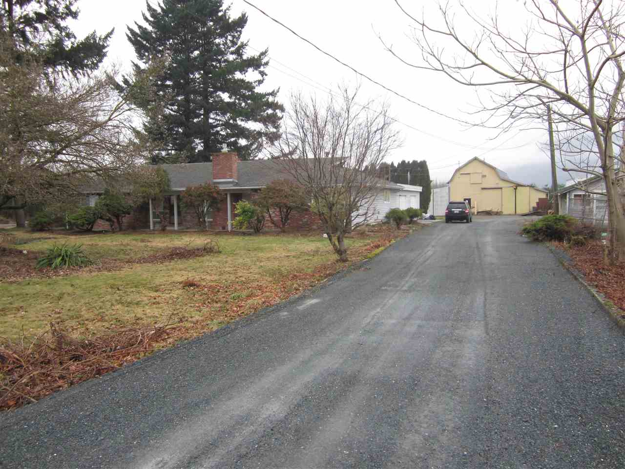 Very good income producing property on city water! 11.83 acres w/ many options acres, 8 acres on lease, 2 acres nut trees. 2208 sq. ft. rancher home on crawl space w/ 3 bdrms, 2 full baths, family rm, rec rm, big laundry. 2 f/p, H/W heat, double garage. Detached 39' x 26' triple garage, 12' x 9' room, 60' x 30' shop w/ 18' ceiling & 16' door, 61' x 37' hip hop barn, 36' x 26' shop, all w/ high doors and 220 power. Very good tenants would like to stay. Call for more information.