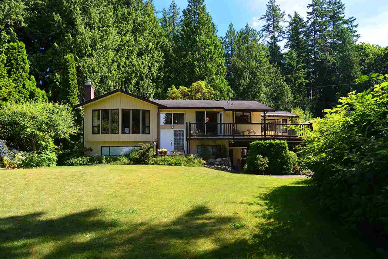Dream of living the casual laid back life in the Creek? Fantastic half acre property located directly across from the Flume Beach Park and of course the best Beach!!! Three bedrooms, den and sunroom with an open concept entertaining area just waiting for your personal stamp. Zoned for a guest cottage, the back yard is gorgeous with cobblestones and beautiful shrubs to make this paradise. Walk to the Roberts Creek store, the Gumboot Restaurant & Library. Enjoy the everyday ambiance of Beach Avenue.