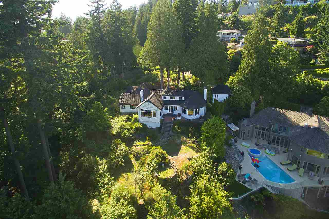 HISTORICAL SEMI-WATERFRONT GREYSTONES ESTATE ? Built by Vancouver?s 11th Mayor, Frederick Buscombe. This TROPHY property is approximately ONE ACRE in size & has an amazing 252 ft of frontage, with only a narrow strip of sloping ?parkway? separating the property from the sensational sandy beach. Located on prestigious ?Piccadilly Rd?, this wonderful character home offers complete privacy and features, on the main floor, large private living & dining rooms, spacious family room, kitchen, stunning master with ensuite, plus 3 additional bedrooms. The upper floor has 2 bedrooms & 2 bathrooms, while the basement offers tons of room for storage. An amazing investment opportunity or spectacular property to build your DREAM HOME.